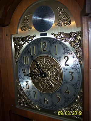 Colonial grandfather clock face